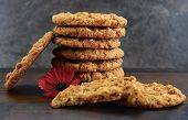 picture of biscuits  - Traditional Australian Anzac biscuits with red poppy on wood and slate background - JPG