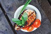 stock photo of salmon steak  - grilling salmon steak with milk cream in grid over barbecue - JPG