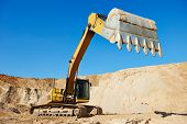 stock photo of sand gravel  - excavator machine at excavation earthmoving work in sand quarry - JPG