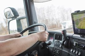 picture of opposites  - The truck driver while driving - JPG