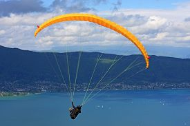 pic of annecy  - paraglider flying above Lake Annecy in France - JPG