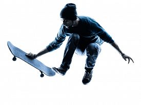 stock photo of skateboard  - one caucasian man skateboarder skateboarding in silhouette isolated on white background - JPG