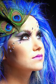 image of female peacock  - Portrait of a Woman in Blue Wig and Peacock Feathers - JPG