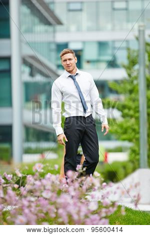 Young businessman standing in front of the office in the city