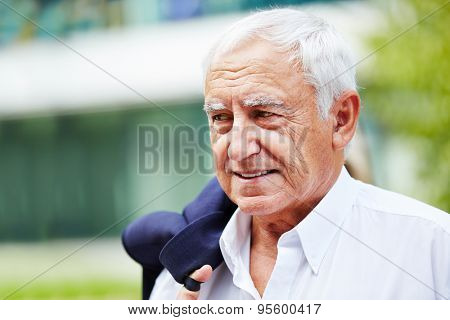 Senior business man outdoors with a white shirt in summer