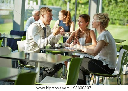 Business people sitting at table in a restaurant for a meeting