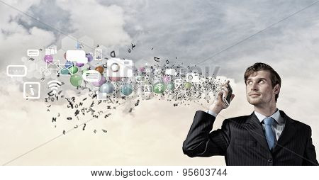 Young businessman holding mobile phone representing e-commerce concept