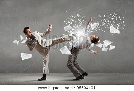 Two businesspeople in anger fighting with each other