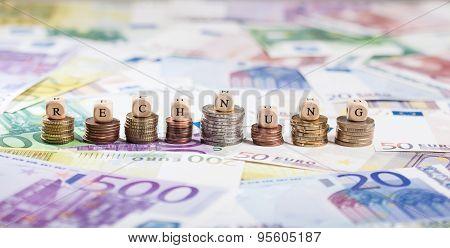 German Word Rechnung On Coin Stacks, Cash Background