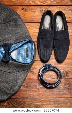 Men's Suit, Belt And Footwear On A Wooden Background