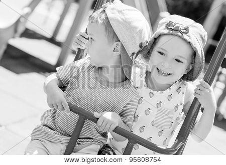 Happy Little Kids On A Swing