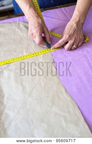 Closeup Of Hands Of Seamstress Working