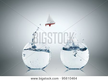 Conceptual image with two aquariums filled with clear water