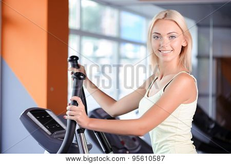 Blond girl in a fitness club