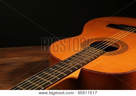 Acoustic guitar on dark background