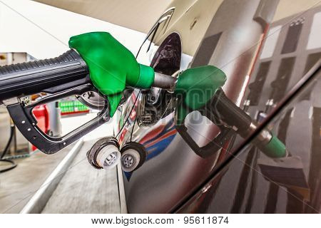 Refilling car fuel on the gas station