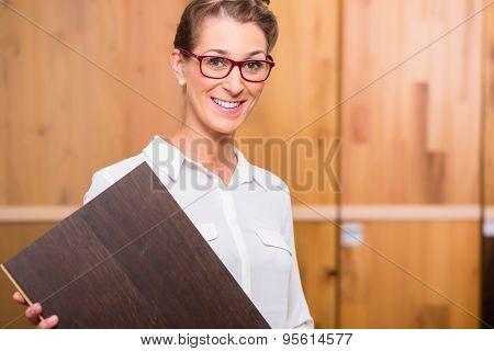 Interior architect choosing parquet wood floor in home improvement store