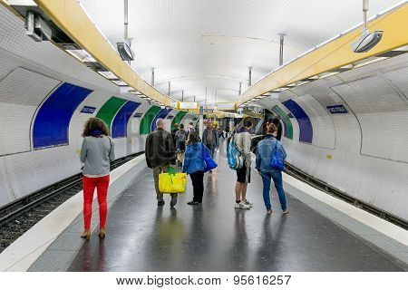 Travellers Waiting At Subway Station Place D'italy In Paris, France