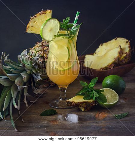 Cold Refreshing Pine Apple Cocktail Drink With Lime,  Mint And Ice Cubes