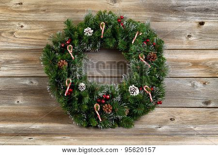 Christmas Wreath With Decorations On Rustic Wooden Boards