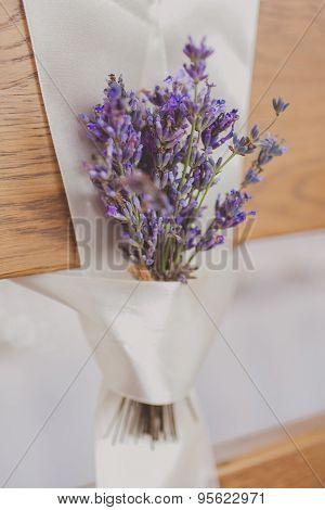 Beautiful wedding chairs lavanda flower decorations