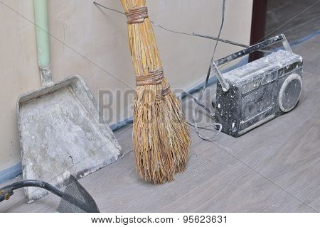 Shovel, Broom And Old Radio