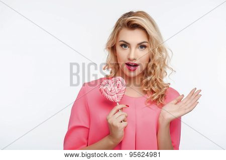 Attractive young girl with amazing sweet gift