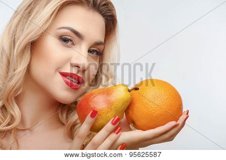 Attractive young girl with two tasty fruits