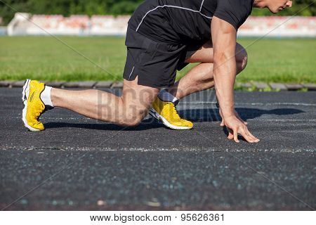 Handsome young athlete is ready to start running