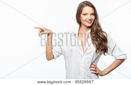 Attractive young girl with pretty smile is presenting something