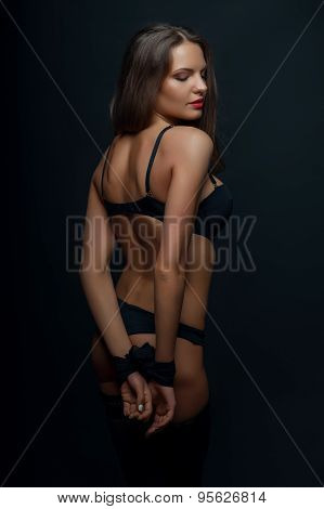 Cheerful young woman is playing games in sexy clothing