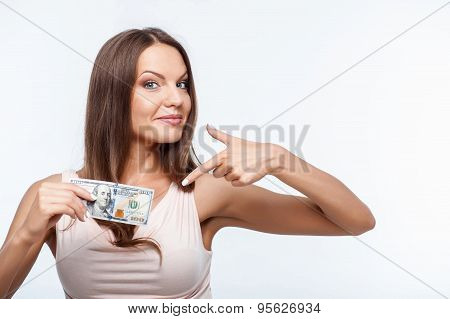 Attractive young healthy girl is showing money