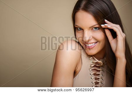 Cheerful young woman is flirting with someone