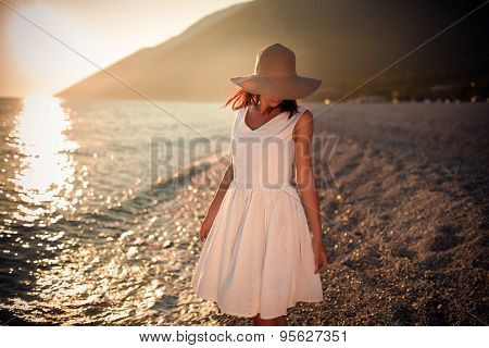 Carefree woman dancing in the sunset on the beach.Vacation vitality healthy living concept.Free woma