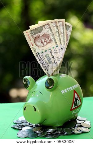 Piggy Bank With Sunset Light - Money Concept