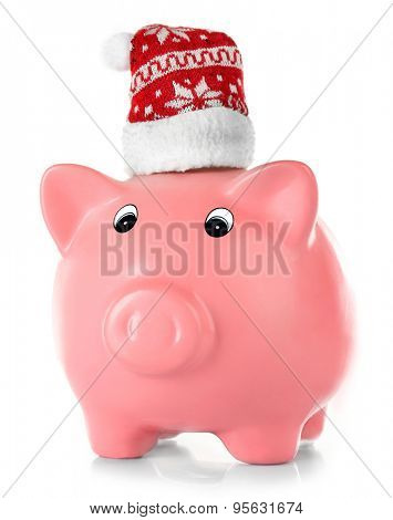 Piggy bank with Santa hats isolated on white