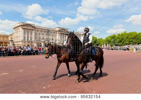 LONDON - JUNE 24: Metropolitan Police Mounted Branch secure the British Royal Guards change next to Buckingham Palace on June 24, 2015 in London, UK. Police officers on horses are to control crowd