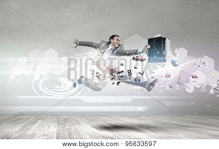 Young businessman in suit running in a hurry
