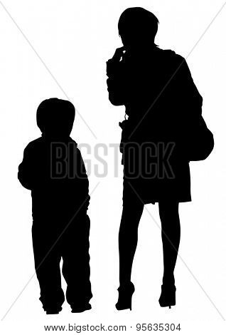 Silhouette of a mother and son on walk