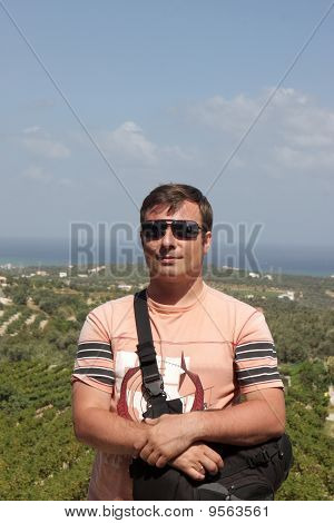 Man Poses In Vineyard