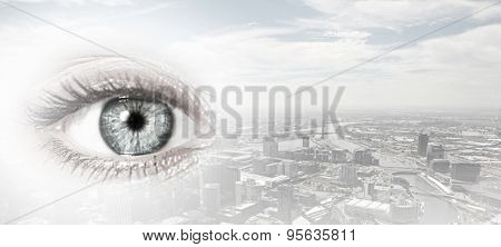 Bird eye view of modern city with human female eye