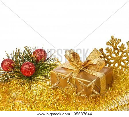 christmas decor gift box with tinsel on white background