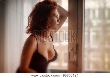 Glamour Glow Artistic Soft Focus Portrait of a beautiful woman near window of a house in Amsterdam