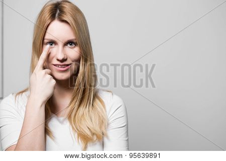 Female Applying Contact Lens