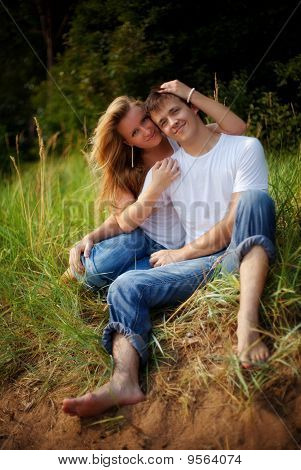 Couple Embrace In High Grass