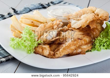 Fish And Chips With Tartar Sauce On A Plate