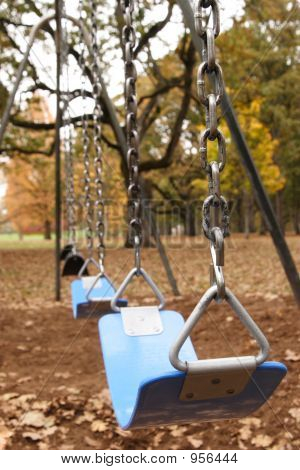 Swing Set In Autumn