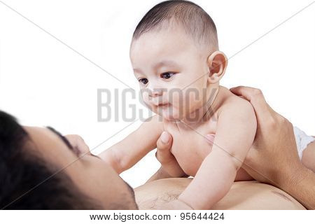 Curious Infant Stares His Father