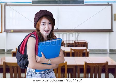 Friendly High School Student Smiling In Class