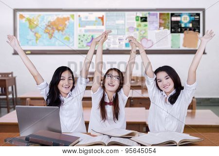 Group Of Student Celebrating Achievement In Class